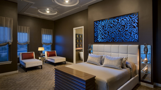 This master bedroom is unrecognizable from the original. bedroom, ceiling, home, interior design, living room, room, suite, wall, brown, black