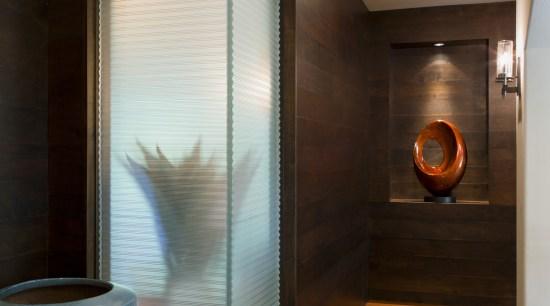 This hallway features walnut paneling. The corner window architecture, bathroom, ceiling, interior design, room, black, brown