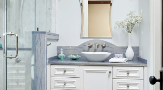 This bathroom by Cheryl Kees Clendenon manipulates color, bathroom, bathroom accessory, bathroom cabinet, cabinetry, floor, home, interior design, plumbing fixture, room, sink, gray
