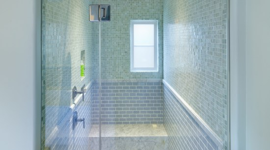 Watery blue-green glass mosaics line the upper walls architecture, bathroom, ceiling, daylighting, floor, glass, interior design, plumbing fixture, room, tile, wall, gray