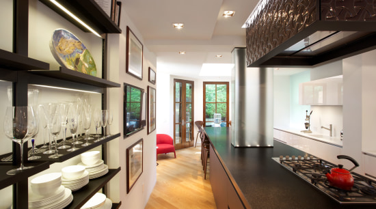To disguise two structural columns that remained in ceiling, interior design, gray, black
