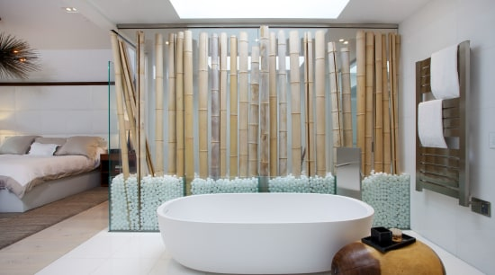 The glass wall with bamboo trunks screens the bathroom, bathtub, interior design, plumbing fixture, room, gray