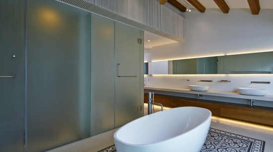Sandblasted doors and walls screen the toilet and architecture, bathroom, countertop, daylighting, home, house, interior design, room, sink, gray