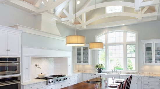 A dramatic cathedral beamed ceiling is centered over architecture, cabinetry, ceiling, countertop, cuisine classique, daylighting, estate, floor, flooring, home, house, interior design, kitchen, living room, real estate, room, wood flooring, gray