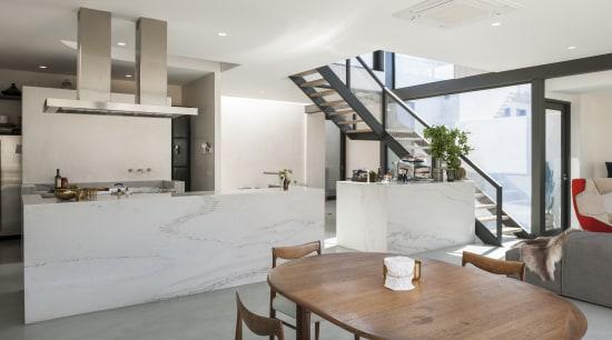 Quartzite stone wraps around the three stainless steel architecture, house, interior design, living room, real estate, gray