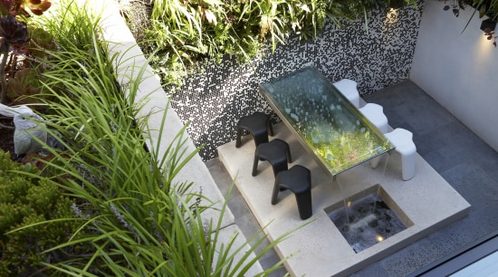 This sustainable house has vertical gardens integrated into backyard, courtyard, flower, garden, grass, plant, water