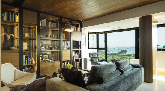 The interior of this renovated 1970s apartment features interior design, living room, real estate, window, brown