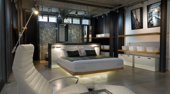 This bedroom and bathroom are essentially one open ceiling, furniture, interior design, black, gray