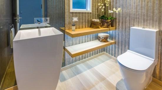 A wall-height smoked glass mirror behind the sculptural bathroom, floor, interior design, plumbing fixture, product design, room, toilet, toilet seat, gray