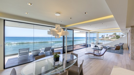 A wall of glass provides dramatic ocean views apartment, architecture, ceiling, condominium, estate, home, house, interior design, living room, penthouse apartment, property, real estate, window, gray