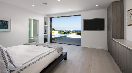 Two sliding glass panels pocket back into the bedroom, floor, interior design, property, real estate, room, window, gray