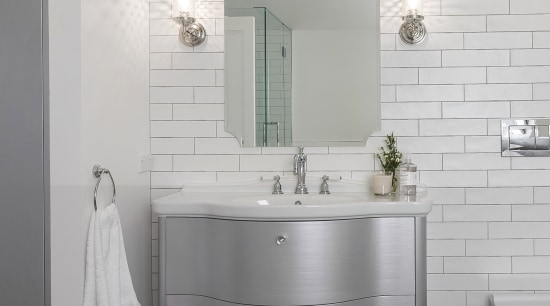 With plenty of reflective surfaces, including mosaic tiles, bathroom, bathroom accessory, bathroom cabinet, floor, flooring, interior design, plumbing fixture, product, product design, room, sink, tap, tile, wall, gray