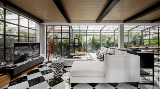 An expansive downstairs living space was transformed beyond architecture, house, interior design, living room, furniture, furnishings, tile floor,  glass extension, contemporary, renovation