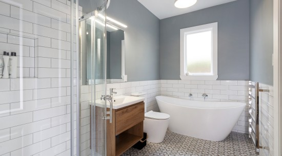 This cottage makeover by Hunter Anderson Architecture includes architecture, bathroom, bathroom accessory, bathroom cabinet, building, ceiling, floor, furniture, home, house, interior design, plumbing fixture, property, real estate, room, tile, gray