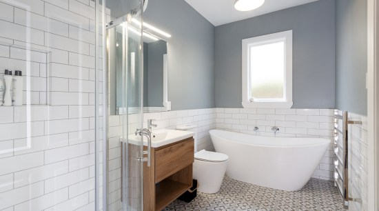 A period-look wall colour, classic freestanding tub and architecture, bathroom, bathroom accessory, bathroom cabinet, building, ceiling, floor, furniture, home, house, interior design, plumbing fixture, property, real estate, room, tile, gray