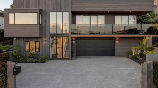 Introducing natural slatted timber cladding brings rhythm, texture architecture, building, concrete, courtyard, door, driveway, estate, facade, garage door, home, house, property, real estate, residential area, roof, gray