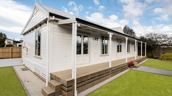 Niagaras Rusticated Weatherboards On Moveable David Wraight House cottage, facade, home, house, property, real estate, siding, white