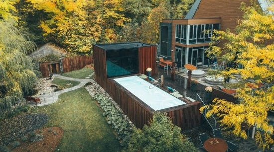 The new pavilion adds capacity to the spa, architecture, autumn, backyard, building, cottage, courtyard, design, estate, garden, home, house, landscape, landscaping, leaf, mountain, nature, plant, property, real estate, residential area, roof, sky, tree, woody plant, yard, yellow, brown