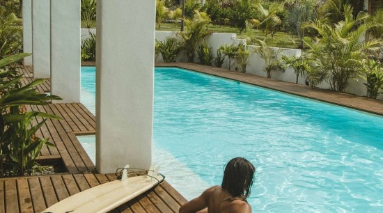 Swell - a surf and lifestyle hotel - building, caribbean, eco hotel, fun, house, leisure, outdoor furniture, palm tree, resort, summer, sunlounger, swimming pool, tree, tropics, vacation, brown