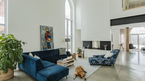 Neogothic architecture with contemporary character architecture, blue, building, ceiling, coffee table, comfort, couch, estate, floor, furniture, home, house, interior design, living room, loft, property, real estate, room, slipcover, sofa bed, table, wall, gray