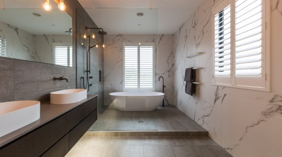 The bathroom has an open, walk-in wet area architecture, bathroom, floor, interior design, room, gray