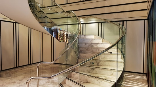 Doubletree Hilton 1 - architecture   baluster   architecture, baluster, building, ceiling, daylighting, glass, handrail, interior design, iron, material property, metal, stairs, orange, brown