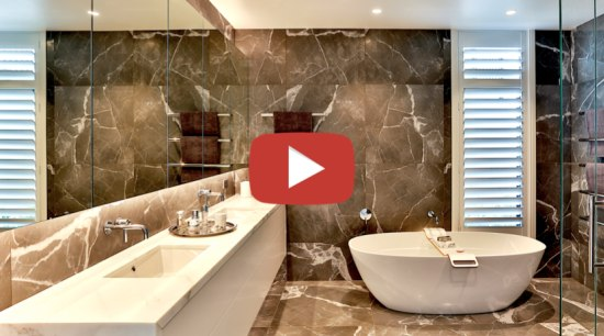 Dunlop Design Designer Suite video button - architecture architecture, bathroom, bathtub, building, ceiling, ceramic, design, floor, flooring, furniture, home, house, interior design, marble, material property, plumbing fixture, property, real estate, room, tap, tile, wall, orange, brown