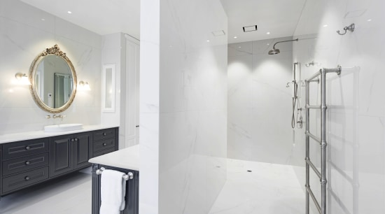 This shower area is L-shaped, with the shower architecture, bathroom, design, floor, flooring, tile, wall, white, gray, rain showerhead, Ingrid Geldof, vanity wall