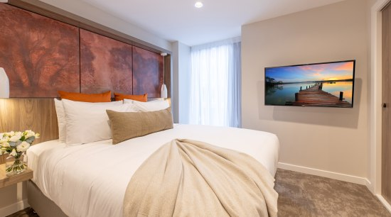 Sudima Christchurch City features two Resene neutrals in bed, bed frame, bed sheet, bedding, bedroom, boutique hotel, building, ceiling, comfort, estate, floor, furniture, hardwood, home, house, interior design, property, real estate, room, suite, wall, wood flooring, gray
