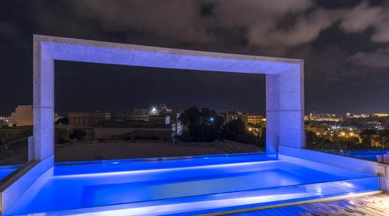 After dark, the pool takes on a party-like architecture, blue, building, design, home, house, interior design, lighting, majorelle blue, night, property, rectangle, room, sky, swimming pool, black, blue