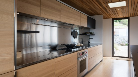 ​​​​​​​A large stainless steel splashback and rear benchtop cabinetry, countertop, cuisine classique, interior design, kitchen, real estate, brown
