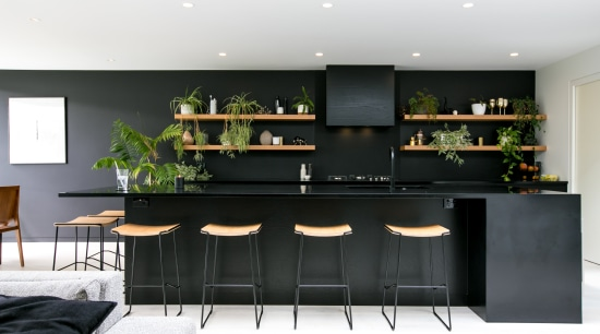 Paint choices help downplay on-view kitchen's functionality furniture, home, interior design, kitchen, living room, table, white, black