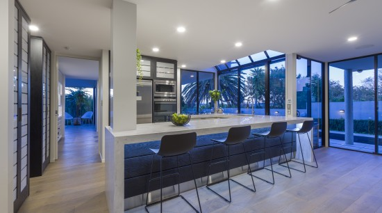 Crisp Corian benchtops play off the warm wood architecture, house, home, kitchen, fyfe Kitchens, Kira Gray, Corion, benchtop, kitchen renovation