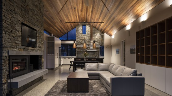 Polished concrete floors run through this home. Besides architecture, building, design, floor, flooring, furniture, home, house, interior design, lighting, living room, timber ceiling, fireplace, Condon Scott Architects