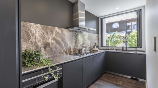 Stainless steel benchtops in this scullery provide a architecture, scullery, cabinetry, countertop, benchtop, stainless steel, marble, splashback, Studio Italia