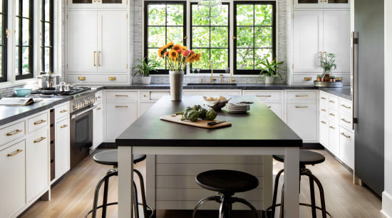 ​​​​​​​This kitchen reflects a rich materiality, with touches bar stool, cabinetry, ceiling, countertop, dining room, floor, timber flooring, furniture, home, house, interior design, kitchen, kitchen stove, stool, table, wood flooring, Studio Dearborn