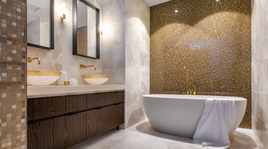 ​​​​​​​Gold-painted basins and glittering feature walls in this architecture, bathroom, bathtub, floor, flooring, interior design, marble, plumbing fixture, tap, tile, gold painted basins, feature wall, Davinia Sutton