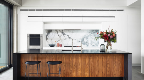 A slender granite island benchtop with waterfall ends architecture, building, cabinetry, countertop, furniture, home, house, interior design, kitchen, material property, property, room, table, white