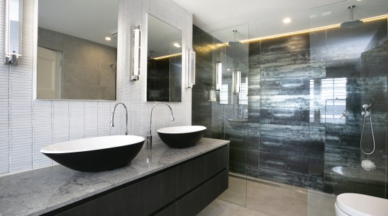 ​​​​​​​An open shower stall, backed in metallic, large-format architecture, bathroom, bathtub, building, ceiling, floor, flooring, furniture, home, house, interior design, material property, plumbing fixture, property, real estate, room, sink, tap, tile, gray, white