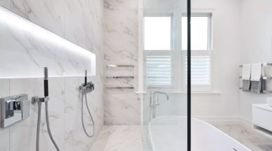 A floor-to-ceiling glass shower wall gives this bathroom bathroom, floor, home, interior design, property, room, tap, tile, white