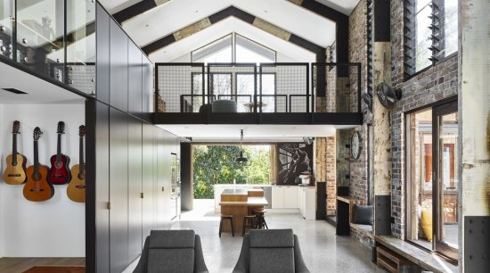 The large double height volume space includes the ceiling, interior design, living room, loft, gray, white