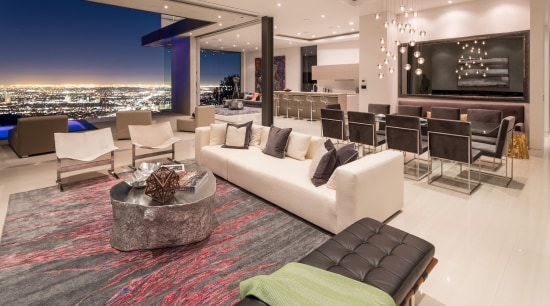 The home opens up to the city - floor, flooring, home, interior design, living room, penthouse apartment, property, real estate, orange