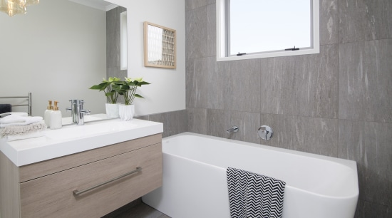 Is the bathroom used by visitors? bathroom, bathroom accessory, bathroom cabinet, floor, home, interior design, plumbing fixture, product design, room, sink, tap, tile, gray, white