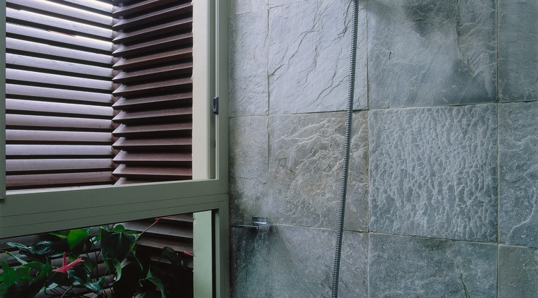 Detail of a shower with stone wall tiles, architecture, glass, house, plumbing fixture, wall, window, gray, black