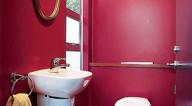 A bright, colourful bathroom bathroom, bathroom accessory, interior design, plumbing fixture, purple, red, room, toilet, toilet seat, red