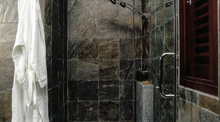 A shower in a natural situation bathroom, plumbing fixture, room, wall, window, black, gray
