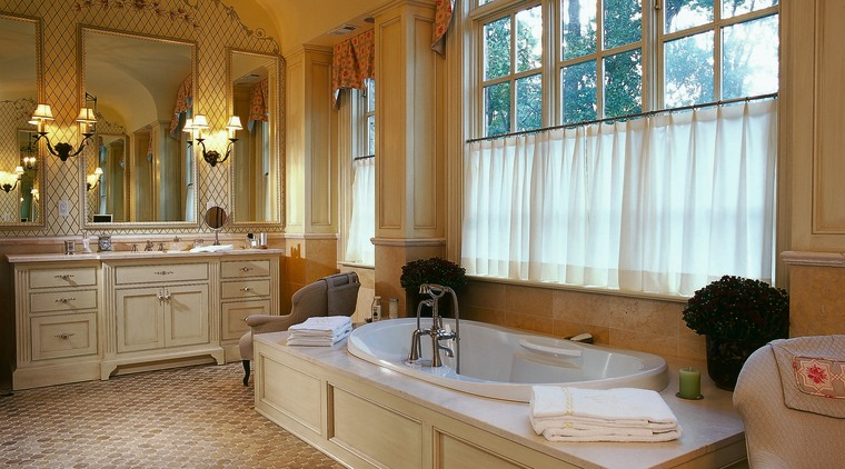 The bathtub of this luxury bathroom bathroom, ceiling, countertop, estate, floor, flooring, home, interior design, real estate, room, window, brown