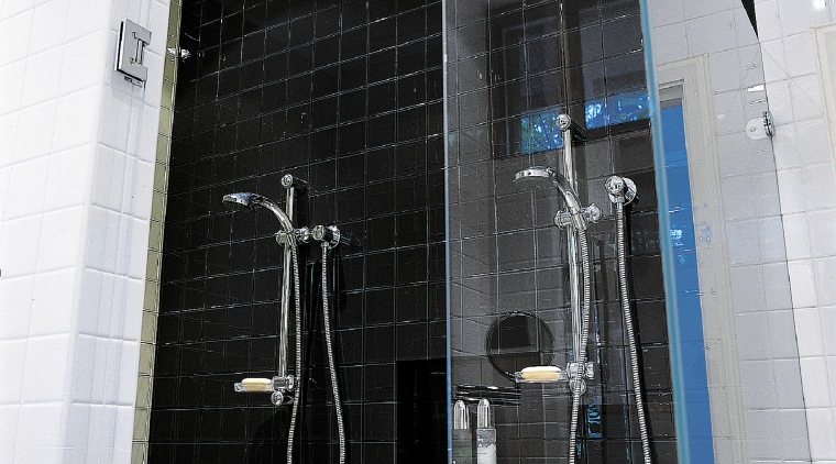 shower with black tiles and frameless shower screen bathroom, glass, plumbing fixture, window, black, white