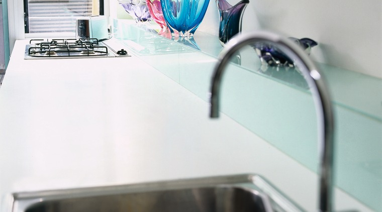 The detail of a sink and benchtop countertop, plumbing fixture, product design, room, sink, table, tap, white