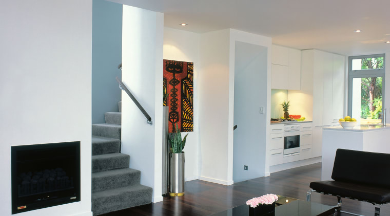 View of the living space & stairway furniture, hearth, interior design, living room, room, table, gray
